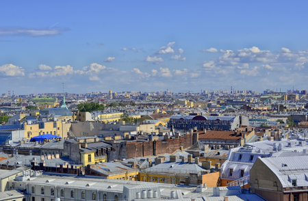 Panorama of the city from above. Densely located roofs of buildings, domes, pipes, towers. Фото со стока