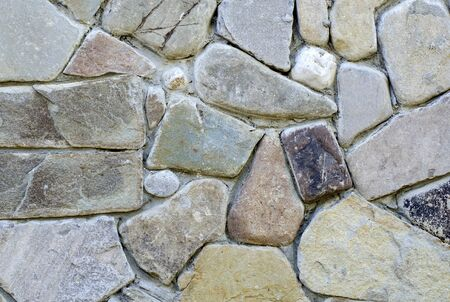 Close-up of a clastic structure of densely laid large pebbles of sandstone.