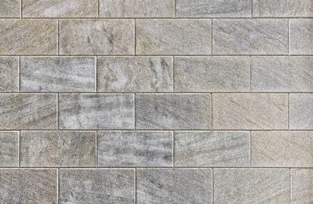 Rectangular blocks of dark gray color folded in horizontal rows.