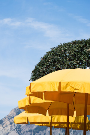 sunburned: Yellow Parasol, protecting against the sun. Stock Photo