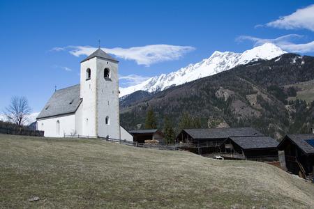 matrei: Romanesque Church St. Nikolaus, built in the 13th century, located at a hill near Matrei, Austria.