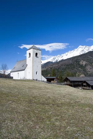 matrei: Romanesque Church of St. Nicholas built in the 13th century located at a hill near Matrei Austria. Stock Photo