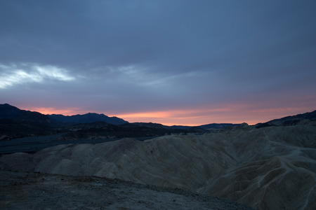 point of view: Sunrise at Zabriskie Point View Point in the area of Amargosa Range mountains in the Death Valley National Park.