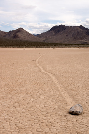 seasonally: Racetrack Playa is a seasonally dry lake playa located in the northern part of the Panamint Mountains That is famous for Rocks That mystery move across its surface. Stock Photo