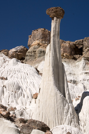 ghost rock: Wahweap Hoodoos (White Ghosts) in Utah, USA, a group of pinnacles and balanced rocks surrounded by undulating mounds and cliffs of white entrada sandstone. Stock Photo