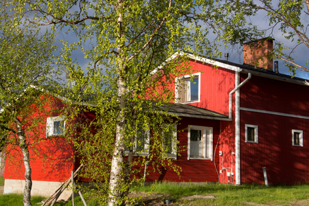 timbered: Typical red timbered house in Lapland, Finland, in the evening. Stock Photo