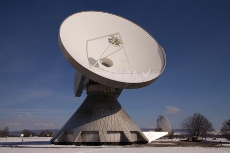 parabolic: The Satellite Earth Station Raisting  is a ground communication parabolic antenna complex for telecommunication. Stock Photo