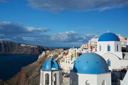 thera: Oia is a village in the Cyclades. It is located on the main island Thira, or Thera, at Santorini, Greece Stock Photo