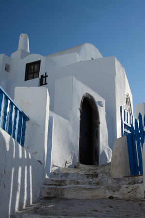 thera: Oia is a village in the Cyclades. It is located on the main island Thira, or Thera, at Santorini, Greece Editorial