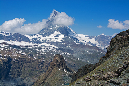 watershed: The Matterhorn is a mountain of the Alps, straddling the main watershed and border between Switzerland and Italy.