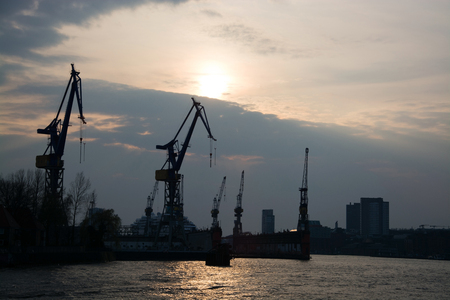 freeport: Hamburg Harbor at the Elbe during sunset.