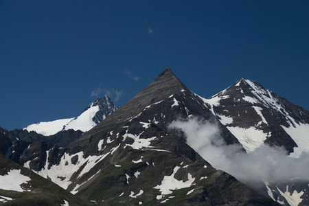 The Grossglockner High Alpine Road is the highest surfaced mountain pass road in Austria. It connects Bruck in the state of Salzburg with Heiligenblut in Carinthia Stock Photo