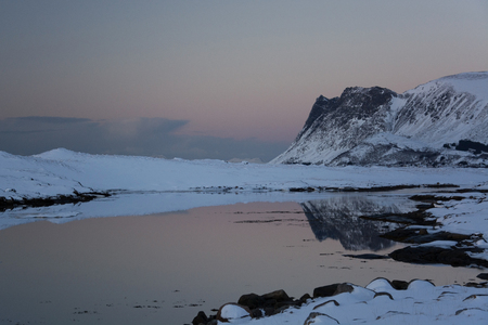 Mirroring in a lake at Knutstad at the Lofoeten, Norway, in winter time evening. Stock Photo