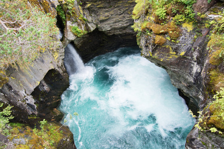Gudbrandsjuvet is a 5 metre narrow and approx. 25 metre high ravine through which the Valldoela River forces itself.