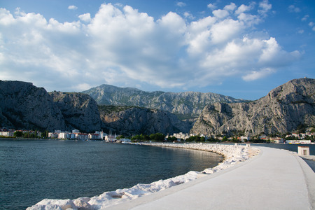 Omis is a town and port in the Dalmatia region of Croatia. Its location is where the Cetina River meets the Adriatic Sea. 스톡 콘텐츠