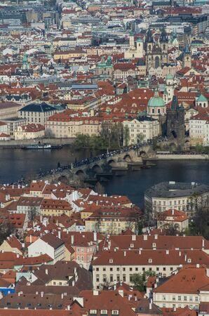 Charles Bridge is a historic bridge that crosses the Vltava river in Prague.