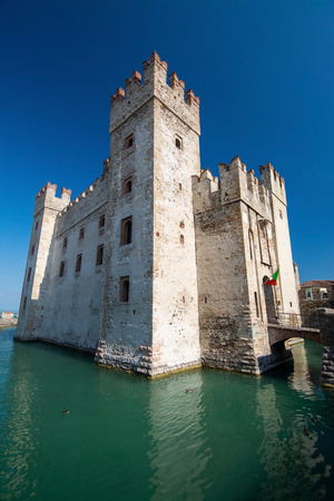 The Scaligero Castle, building started in 1259, is a rare example of medieval port fortification, which was used by the Scaliger fleet. Editorial