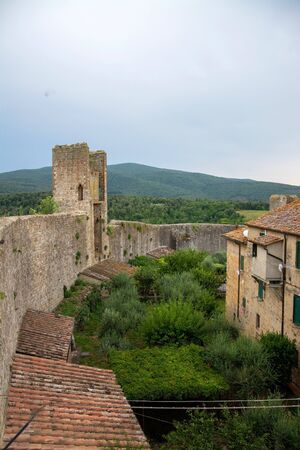 Monteriggioni is a medieval walled town, located on a natural hillock, built by the Sienese in 1214–19 as a front line in their wars against Florence.