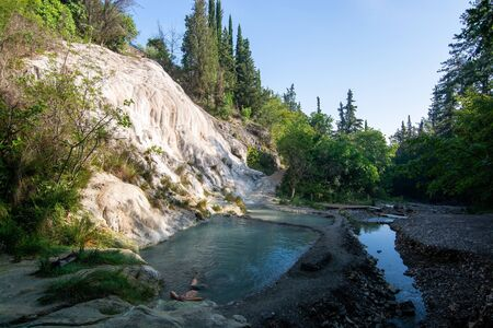 Bagni San Filippo is an area in the Province of Siena, Italy, not far from Monte Amiata. It is a small hot spring which form white concretions and waterfalls.