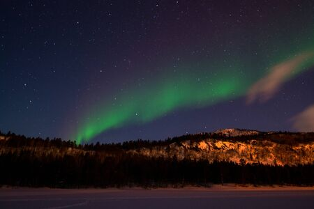 An aurora borealis, sometimes referred to as polar lights or northern lights, is a natural light display in the Earth's sky, predominantly seen in the high-latitude regions.