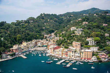 Portofino in Liguria is an Italian fishing village and holiday resort famous for its picturesque harbor and historical association with celebrity and artistic visitors. Zdjęcie Seryjne