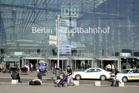 People at entrance to the Central train station of Berlin in the government district of the German capital - Germany.