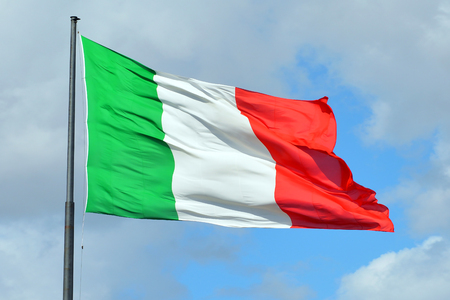 Italian national flag before the railway station in Florence - Italy.