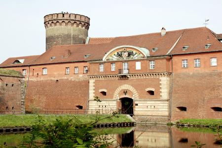 Spandau Citadel in Berlin with man gate and tower Juliusturm - Germany.