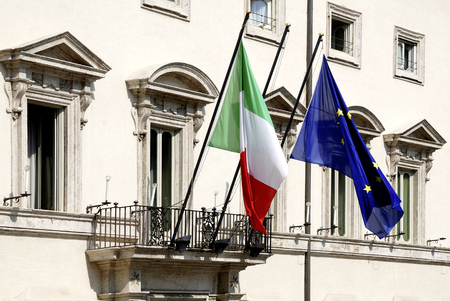 Flags at the Palazzo Chigi at the Piazza Colonna in Rome - Residence of the Italian Prime Minister - Italy. Imagens