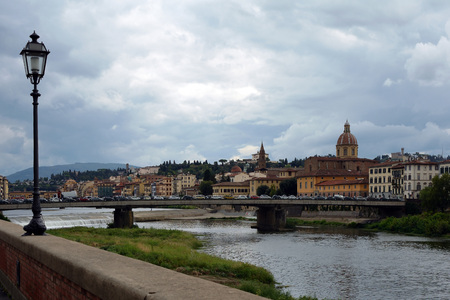 Ponte Amerigo Vespucci bridge over the river Arno in Florence - Italy. Stock Photo