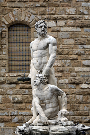 Hercules and Cacus statue from Giambologna in front of the Palazzo Vecchio on the Piazza della Signoria im historic center of Florence - Italy. Stock Photo