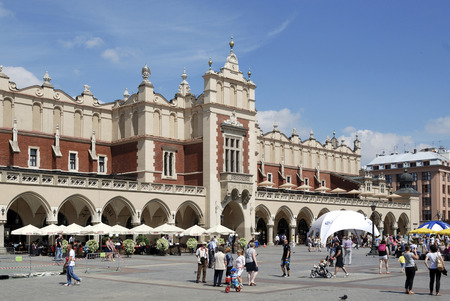 Tourists in front of the Cloth Hall on the Market square of Krakow - Poland.
