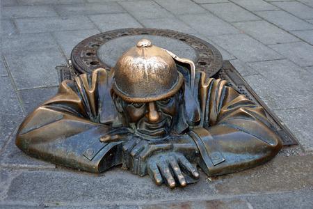 Cumil statue in the Laurinsky street of the Slovak capital Bratislava - Slovakia.