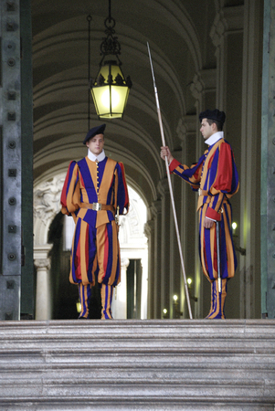 Swiss guardsman of the papal guard duty at the Saint Peters Basilica in the Vatican city in Rome - Italy.