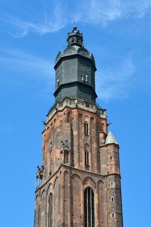 Tower of the St. Elizabeth's Church in the Market Square the historical Old Town of Wroclaw - Poland.