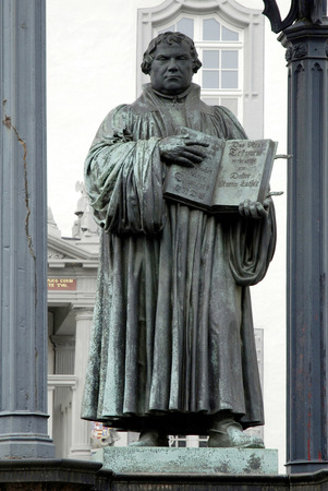 Monument to Martin Luther on the market place in front of the old city hall of Wittenberg - Germany.