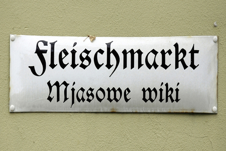 Bilingual road sign in German and Sorbian language.am Main market of Bautzen in the Upper Lusatia in Saxony - Germany.