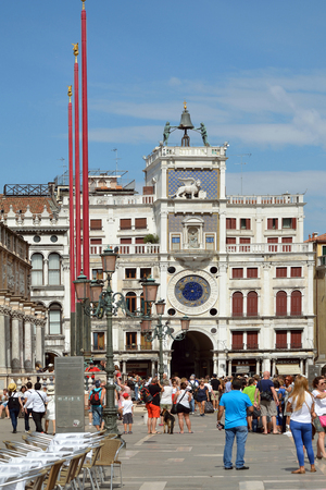 Tourists in front of the Clock Tower at St. Marks Square of Venice, Italy - Terre dell? ? ? Orologio.
