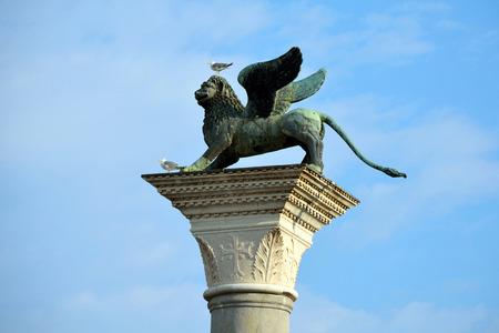 Lion of Saint Mark on a column at St Mark's Square of Venice - Italy. 版權商用圖片