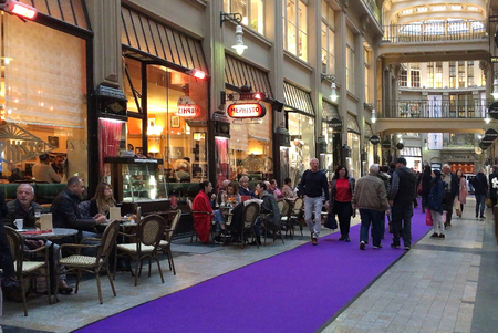 Shopping arcade Maedler Passage with passers-by in front of the historic Cafe Mephisto in Leipzig - Germany.