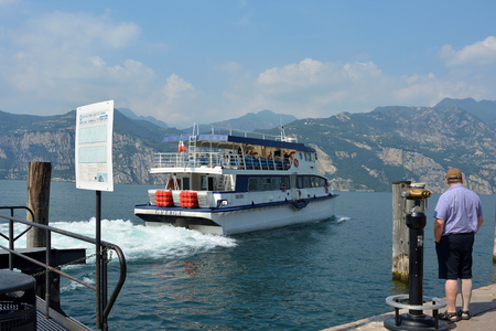 Passenger ship on the Lake Garda in front of Malcesine - Italy.