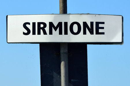 Town sign at the port of Sirmione on the Lake Garda - Italy.