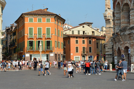 People on the square Piazza Bra in the historic centre of Verona - Italy. Editorial