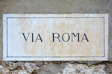 Street sign of the street Via Roma in the historic centre of Verona - Italy.