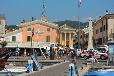 View from the harbor to Piazza Giacomo Matteotti with the Church of San Nicolo and Severo in Bardolino on Lake Garda - Italy. Editorial