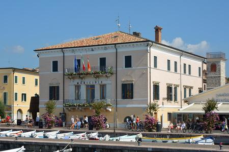Town hall on coastal promenade in Bardolino on the shore of Lake Garda - Italy.