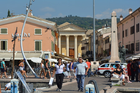 View from the harbor to Piazza Giacomo Matteotti with the Church of Sani Nicolo and Severo in Bardolino on Lake Garda - Italy.