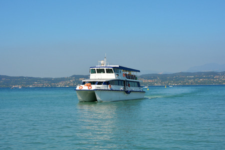 Passenger ship on the way to Desenzano del Garda on Lake Garda - Italy.