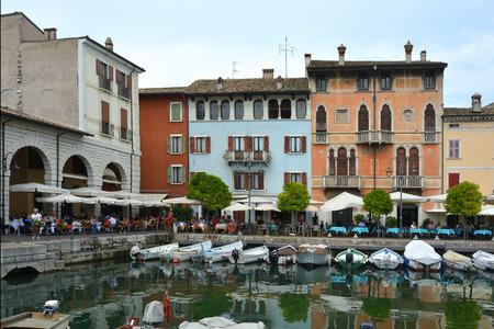 Old port of Desenzano del Garda on Lake Garda - Italy.