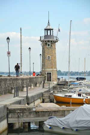 Lighthouse of Desenzano del Garda on Lake Garda - Italy.
